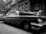 Syd Barrett, Laying On Car, London, 1969 by MICK ROCK